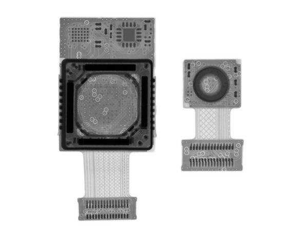 The wee camera next door is the front-facing camera; just a simple lens and image sensor, with no OIS mechanism.