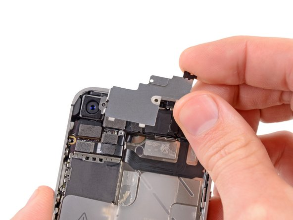 Lift the cable cover from its edge nearest the top and remove it from the iPhone.