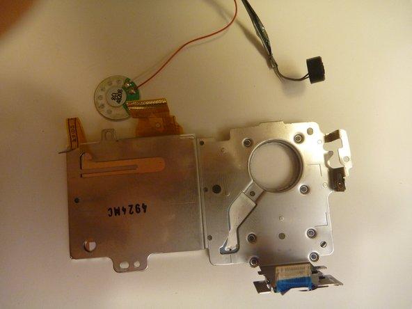 Image 3/3: Remove speaker from holding dock.