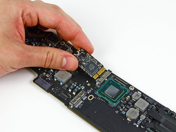 Image 2/2: Remove the AirPort/Bluetooth board from the logic board.