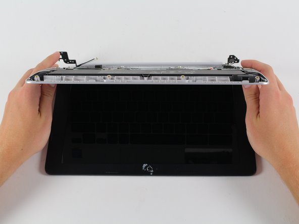 Use your middle fingers to push the back of the Chromebook towards you, and away from the hinges. At this point the keyboard and the screen should be completely seperated