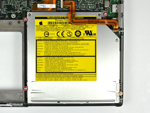Remove the following four screws securing the optical drive to the lower case: