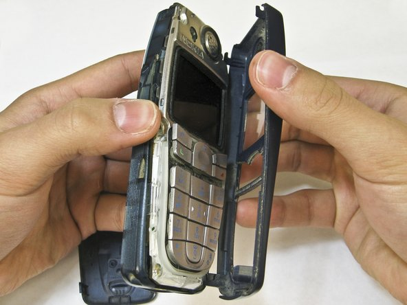 Pull the front case away from the rest of the phone.