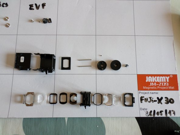 Image 2/3: When re-assembling, there's only one way to get them back in, so keep track of lenses order and direction when removing each one of them. Or wou'll have to try many times to comlete the puzzle.