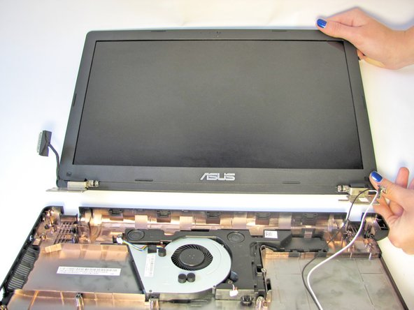 Once the screws are removed, the monitor should easily lift away from the bottom plate cover