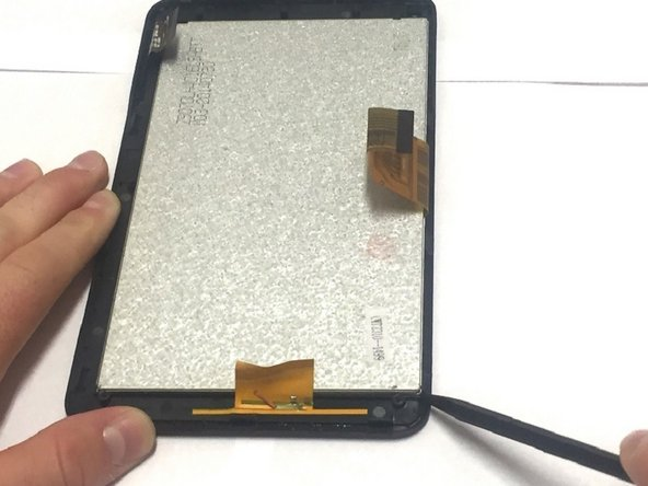 Image 1/2: Gently remove the screen from the device.
