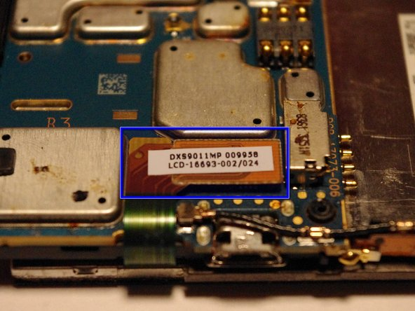 To remove the screen gently pry up this ribbon cable with a pry tool.