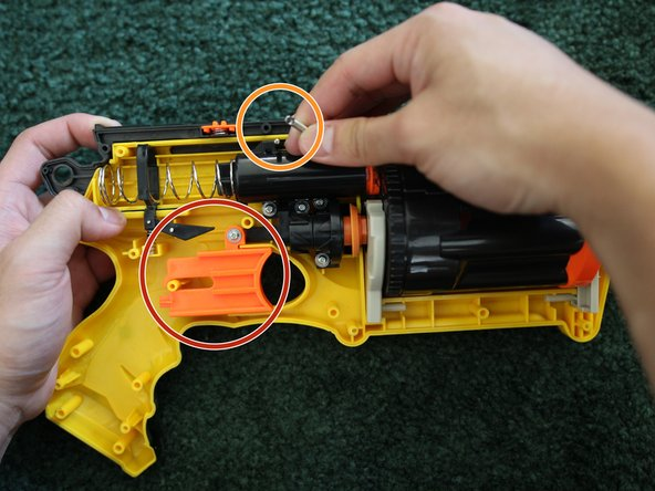 After examining and fixing the chassis, screw the trigger back onto the body.
