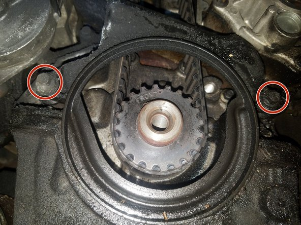 There are two 10mm bolts holding the lower timing belt cover in place