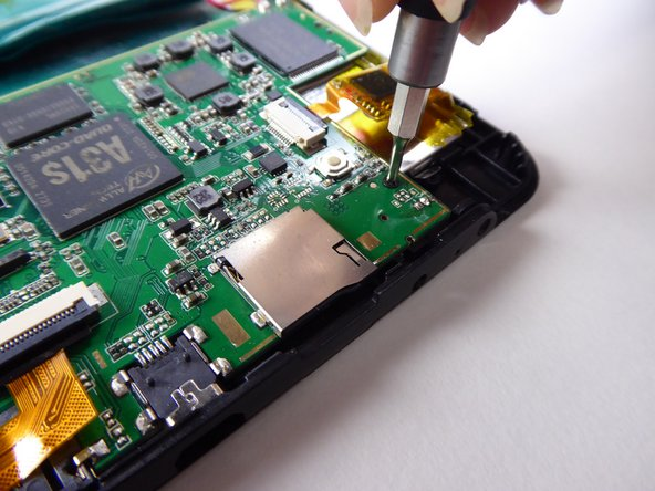 Use a Phillips #000 screwdriver to remove the two 3.6mm screws.