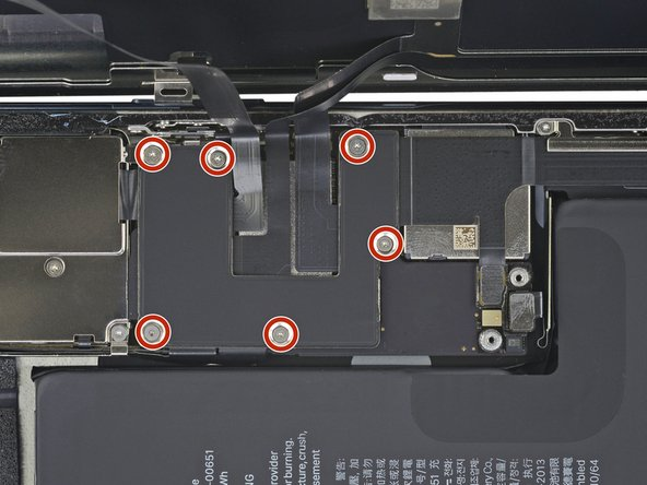 Use a Y000 driver to remove six 1.3 mm screws securing the logic board cover bracket.