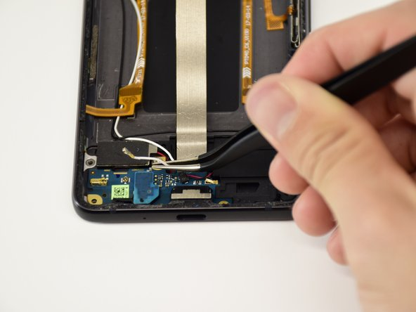 Use the tweezers to pull the white cable on the daughterboard out.