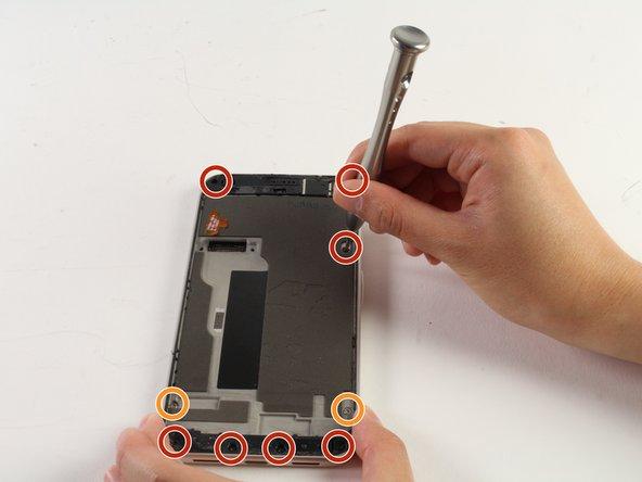 Unscrew the seven black 4mm T5 screws.