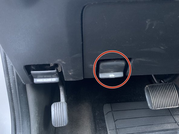 Pull the open hood tab found under the dash by the foot pedals.