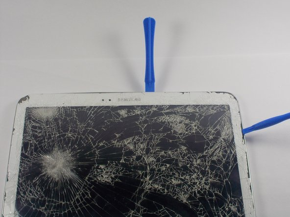 Using your plastic opening tools, carefully start to pry apart your Samsung Galaxy Tab 3 10.1 all along the edge. Do this until the back side of the tablet can be removed.