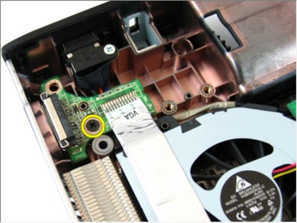 Remove the screw that secures the VGA board.