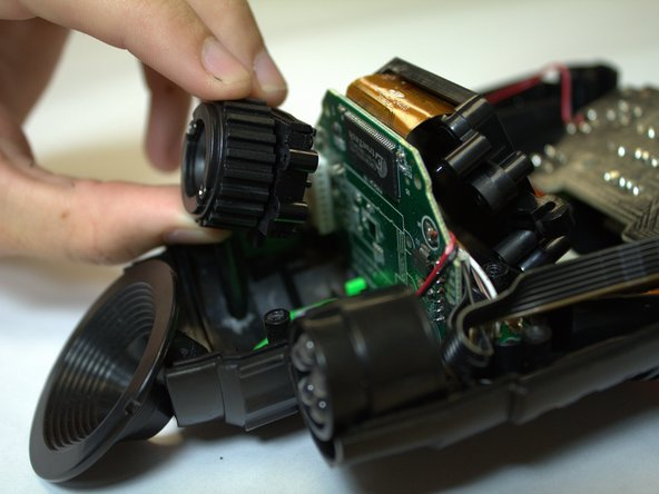 Pull the lens & filter assembly away from the circuit board.
