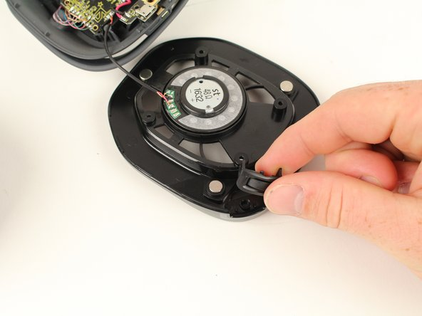 Use your hands to pull the volume wheel up and away from the device.
