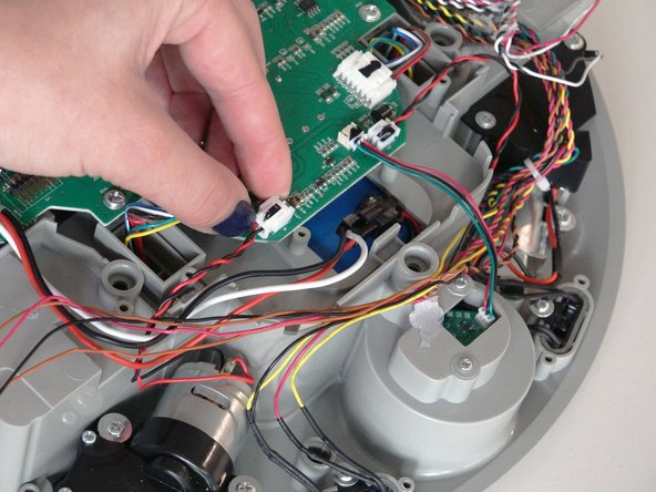 Image 2/2: After re-assembling bObi Pet, remember to re-attach the side brush on the newly installed motor.
