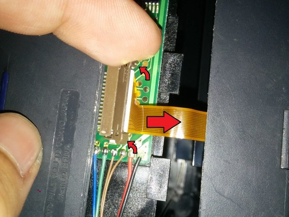 Watch out for the fragile ribbon cable! Do not try to pull the 2 halves completely apart until you disconnect it.