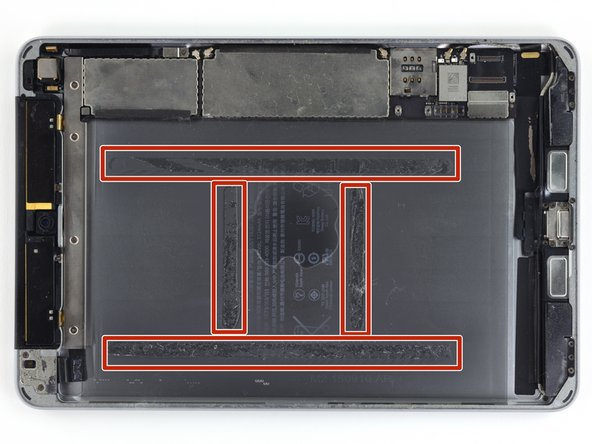 In the following steps you will be cutting the adhesive under the battery, and prying it off of the rear case.