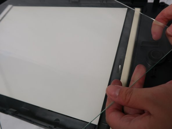 Remove the glass plate with hands.