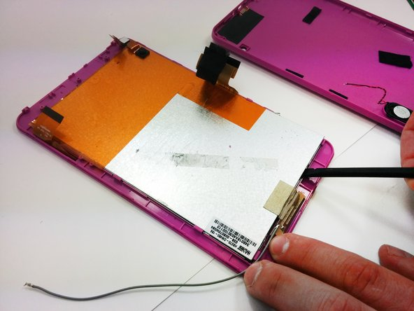 Using a spudger, separate the display surface and the front cover