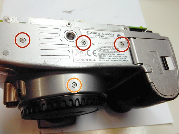 "Remove the three 1/8"" philips screws from the bottom."