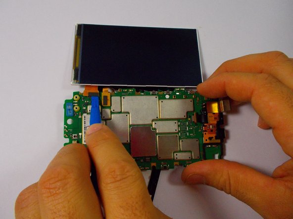 Image 1/2: With the LCD display removed, remove the ribbon cable connecting the touchscreen to the motherboard
