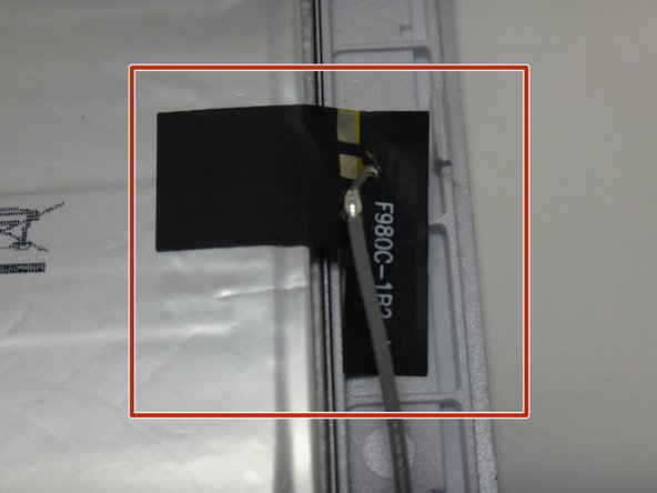 Locate the black sticker connecting the antenna to the battery.
