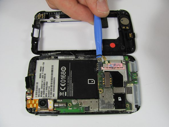 Image 1/1: Disconnect the antenna from its housing on the motherboard by gently lifting beneath it.