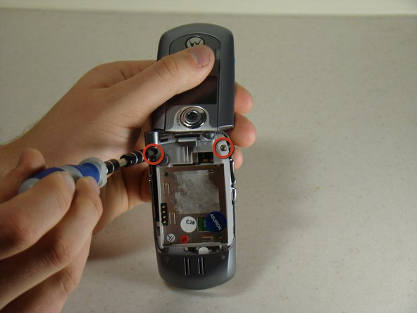 Image 1/1: Unscrew the two screws using a T6 Screwdriver.