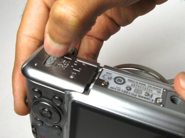 If the initial shutter button dislodge does not work, we have to disassemble the camera.