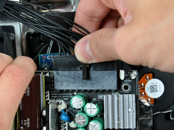 Disconnect the DC power supply cable connector from the power supply by pulling it straight up from its socket.
