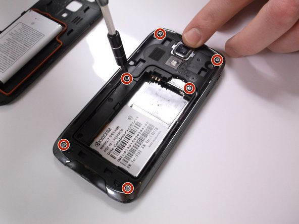 Use a PH00 screwdriver to remove the 6 screws from the mid-frame.