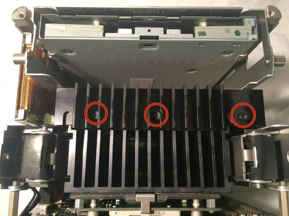 Image 1/1: Carefully slide the hard drive to the open side (side without the IDE and power cables) to remove the drive.
