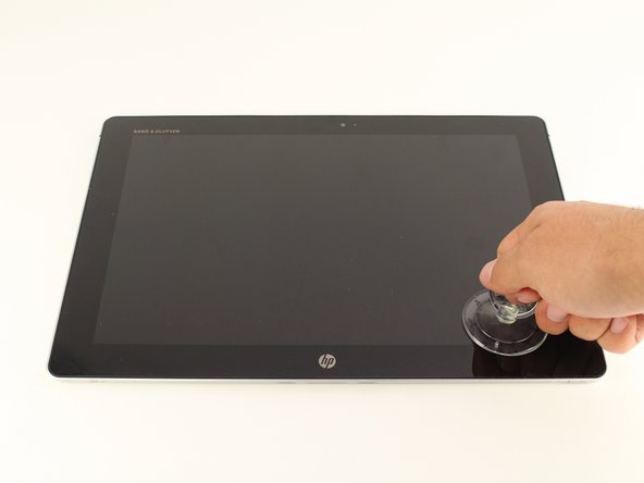 Use the suction cup to carefully separate the screen from the device. Pull upwards with a fluid and smooth motion.