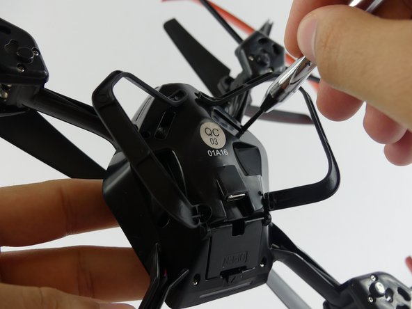 Remove the eight 5.2mm screws located on the drone base using a Phillips 00 screwdriver with a thin end.