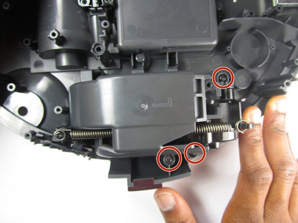 Remove three 10mm Philips #1 screws that are securing the wheel assembly.