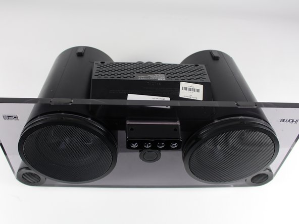 Orient the iHome upside down with the speakers facing you.