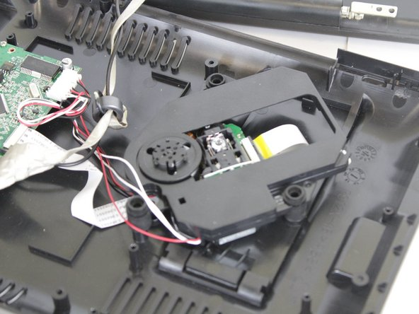 Locate the disk reader, it  will be right under the disk chamber.