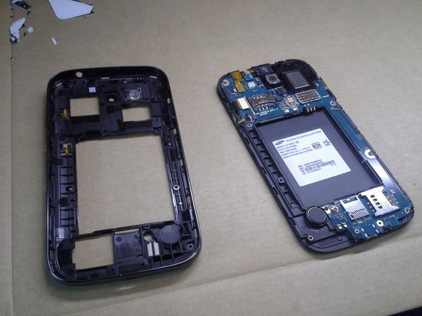 Here you can see the bottom casing separated from the top, now exposes the motherboard.