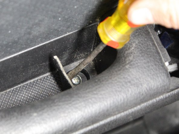 Peel off the rubber insert in the inner arm rest.