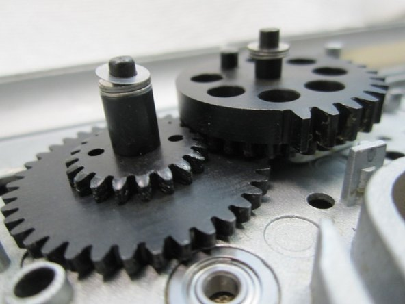 The sector gear has to be shimmed so that it just clears the cut off lever but still meshes with the spur gear.You may have adjust the spur gear if possible to meet the needs of the sector gear.