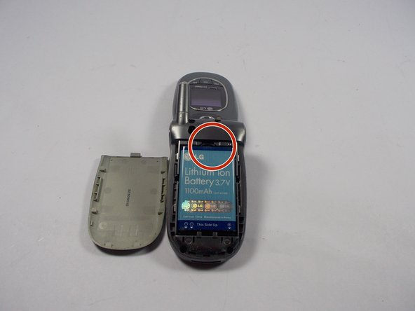Image 1/3: Push down and pull so that the battery pops out away from the body of the phone.
