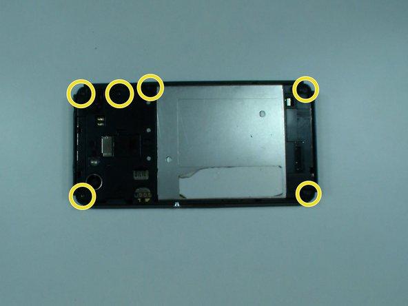 Image 3/3: There are 6x black screws Torx T4, remove them.