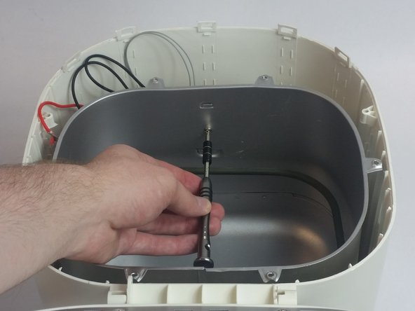 Remove the single 11mm Phillips #1 screw thats holding and inner lining in place.
