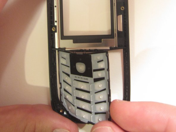 Rotate and remove the keypad from the front case.