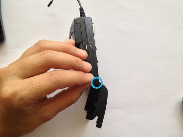 Image 1/3: Push it with your Torx Screwdriver so that the stick slides out, releasing the compartment cover.