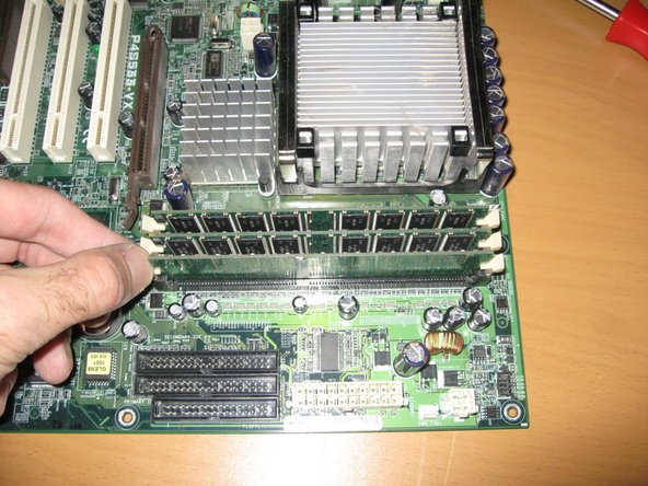 Remove Memory Dimms by lifting out of slot